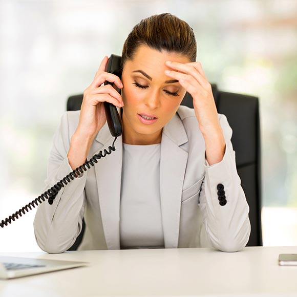 Stressed Business Woman on Phone