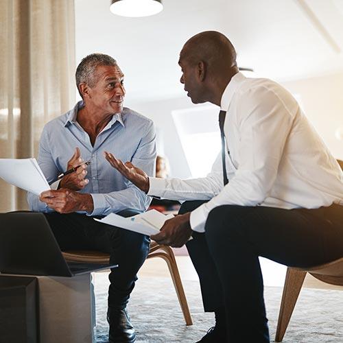 Two Sitting Men Talking