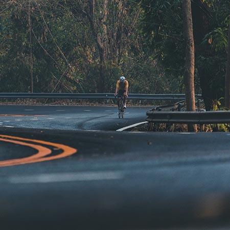 Cyclist Climbing a Hill